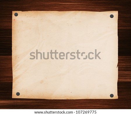 Paper Pinned to a Wooden Plank