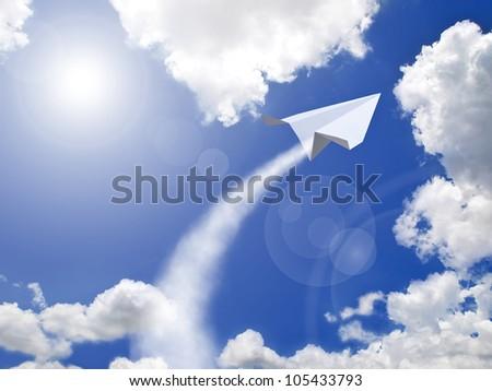 Paper plane flying against blue sky