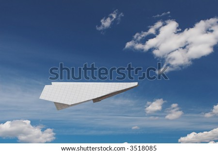 Paper plane flying on a background of the blue sky with beautiful clouds