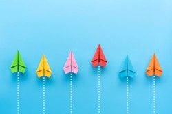 Paper plane on blue background, Business competition concept.