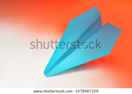 Paper plane on red background. One of a kind. Unique. Special. Different from others. Pioneer. Constant development. Innovations.