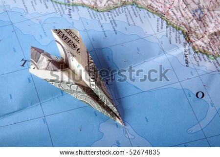 Paper plane on travel map symbolizing and expensive journey