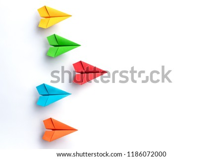 Paper plane on white background. Leadership and Business competition concepts. Copy space #1186072000