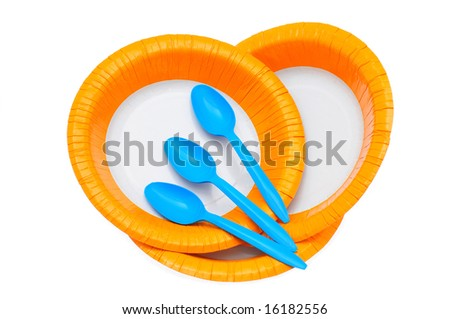 Paper plates and spoons isolated on white background