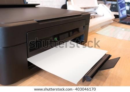 Paper printer. Digital printer. Print concept. Printer on desk. Laser printer. Cmyk ink printer. Scanner paper. Digital scanner. Printer quality. Printer and modern concept. Printout paper. Printer