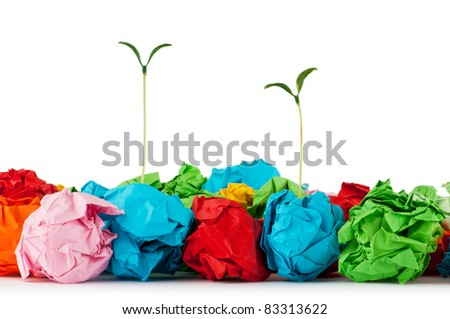 Paper recycling concept with seedlings on white