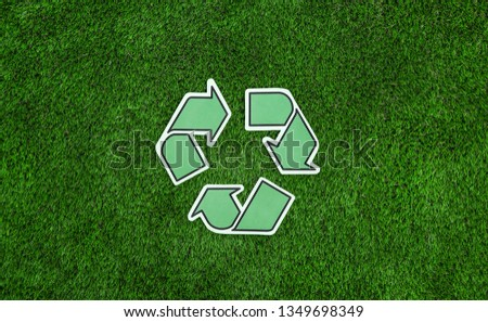 Recycle Icon On Green Grass Texture And Background Images