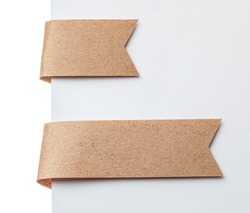 Paper ribbon bookmark or label tags. Craft paper on a white background.