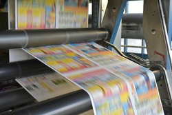 paper rolls and offset printing machines in a large print shop for production of newspapers and magazines