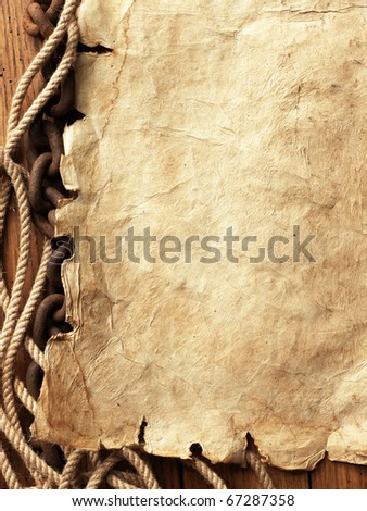 paper, rope, chain on wooden board