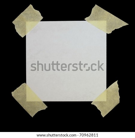 paper scrap and masking tape isolated on black background