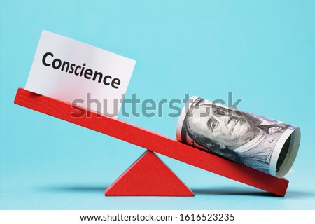 Paper sheet and money on a swing. The concept of conscience Stock photo ©