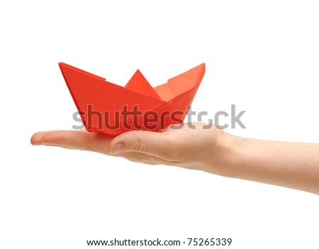 paper ship in a female hand on white - stock photo