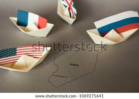 Photo of paper ship with Flags of USA and Russia. conflict in Syria sea, concept shipment or free trade agreement and membership. grunge image