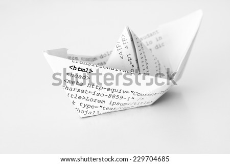 Paper ship with html code. Stock photo ©