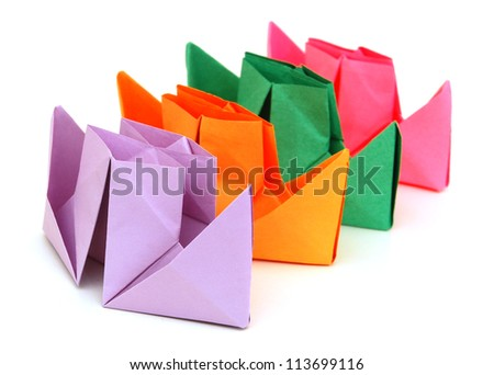 Paper ships on white background