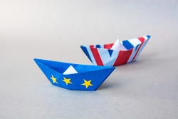 paper ships with European Union and Great Britain flags. Europe and UK - international relations between countries after Referendum vote, brexit concept