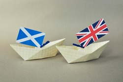 paper ships with flag of Scotland, and UK  United Kingdom, The Union Flag the Saltire - Scottish Independence