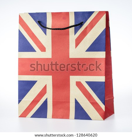 Paper shopping bag in England flag design on white background