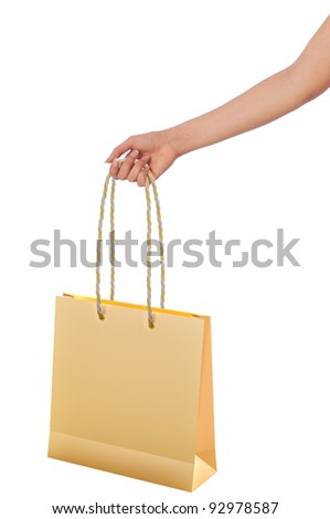 Paper shopping bags from the supermarket in the hand