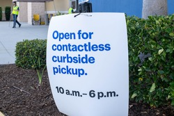 Paper sign announcing curbside pick up caused by covid 19 pandemic