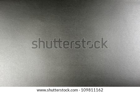 Paper silver white and dark light background closeup texture