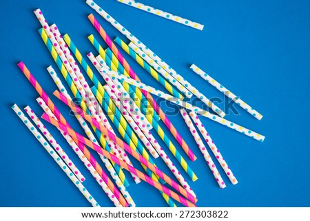 Paper straws on a bright blue background