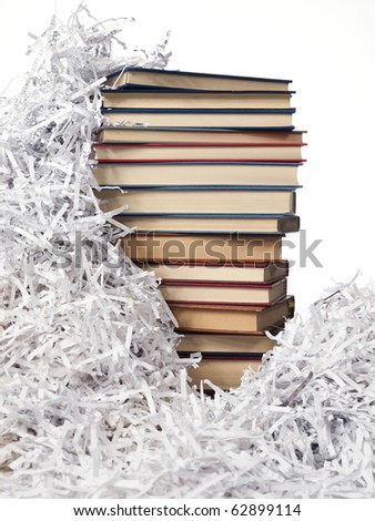 paper strips and pile of books on the white background