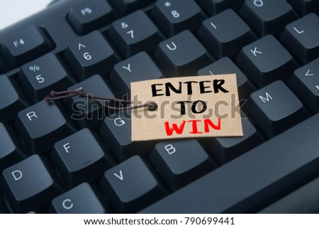 paper tag written enter to win over keyboard background #790699441