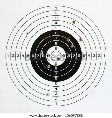 Paper target with holes close up.