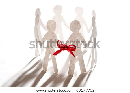paper team linked together with red bow