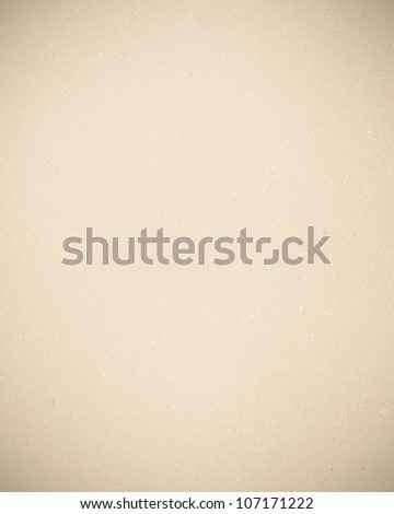 paper texture background in beige color and delicate vignette
