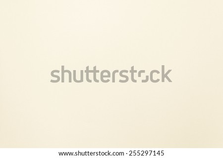 Paper texture background in light cream tone