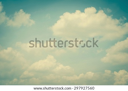 Paper texture background of retro style blurred sky with soft clouds #297927560