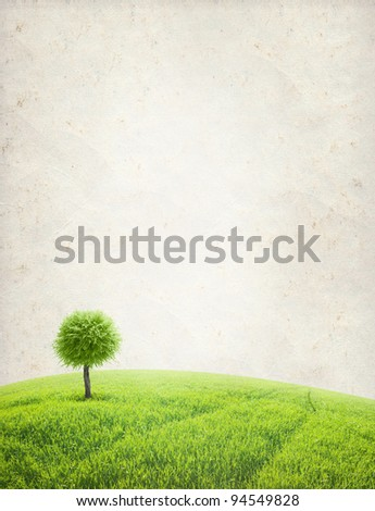 paper texture. Green field with one tree in grunge and retro style