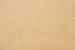 Paper texture in brown. Old paper background with detail of texture.