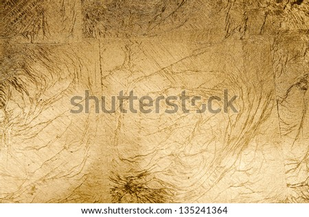 Paper texture in shades of beige and gold