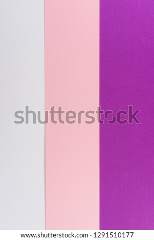 Paper textured background from three colors, violet, white and pink. Vertical lines. Vertical background