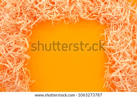 Paper tinsel on a yellow background. The toy is decorative. Decorative background #1063273787