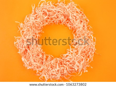 Paper tinsel on a yellow background. The toy is decorative. Decorative background #1063273802