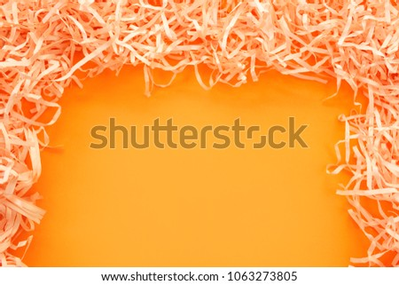 Paper tinsel on a yellow background. The toy is decorative. Decorative background #1063273805
