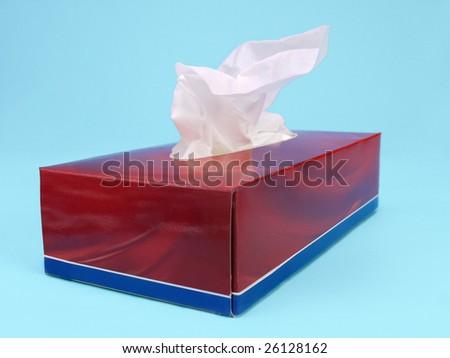 Paper tissue box over light blue background