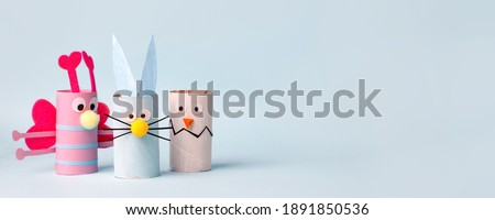Paper toy Happy Easter home party. Easy crafts for kids on blue background, copy space, die creative idea from toilet tube roll, recycle reuse eco concept, kindergarten daycare, banner
