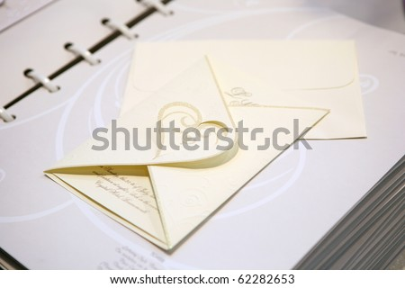 Paper wedding invitation with heart shape