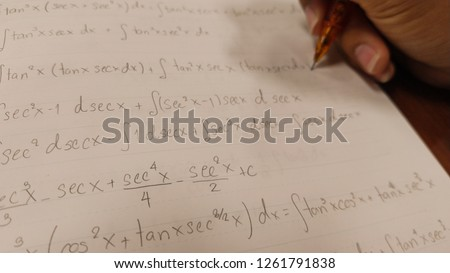 Paper with Mathematics sign and pencil