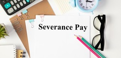 Paper with Severance Pay on a table