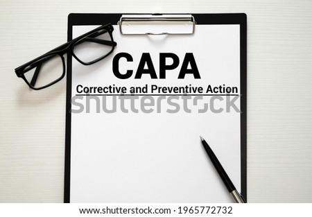 Paper with words CAPA Corrective and Preventive action plans. Stock fotó ©
