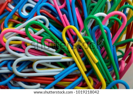 Paperclips multi colored plastic coated, closeup and selective focus.  #1019218042