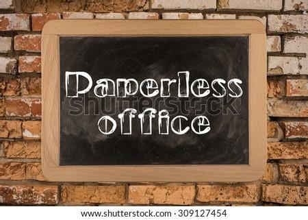 Paperless office on Blackboard. Paperless office on Blackboard on bricks wall