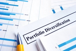 Papers about investment portfolio diversification and pen.